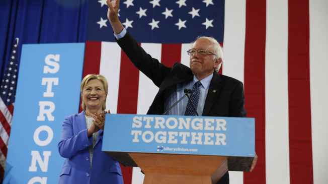 Sen. Bernie Sanders, I-Vt. waves as he a Democratic presidential candidate Hillary Clinton arrive for a rally in Portsmouth, N.H., Tuesday, July 12, 2016. (AP Photo/Andrew Harnik)